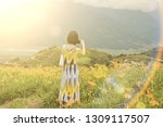 asian woman taking a picture... | Shutterstock . vector #1309117507
