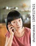 portrait of mature asian woman... | Shutterstock . vector #1309117621