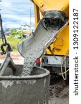 pouring cement down from the... | Shutterstock . vector #1309122187