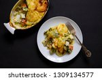 fish pie with sliced potato... | Shutterstock . vector #1309134577