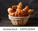fresh croissants in a basket on ... | Shutterstock . vector #1309136344