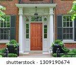 elegant wooden front door of...   Shutterstock . vector #1309190674