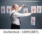 mature businessman staring at...   Shutterstock . vector #1309218871