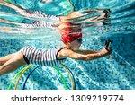 the little girl learned to swim ...   Shutterstock . vector #1309219774