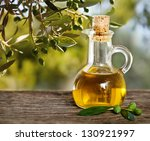 olive oil and olive branch on... | Shutterstock . vector #130921997