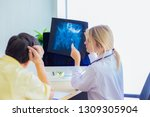 the doctor is diagnosing the... | Shutterstock . vector #1309305904