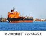 cargo ship sailing in still...   Shutterstock . vector #130931075