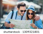 tourist couple in love enjoying ... | Shutterstock . vector #1309321801