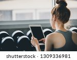 fitness asia woman using tablet ... | Shutterstock . vector #1309336981