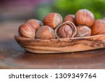 close up of hazelnuts on wooden ... | Shutterstock . vector #1309349764