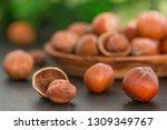 hazelnuts on black stone... | Shutterstock . vector #1309349767