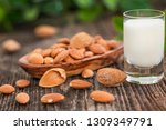 almond milk with almond on a... | Shutterstock . vector #1309349791