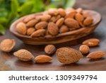 almonds in wooden bowl on... | Shutterstock . vector #1309349794
