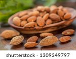 almonds in wooden bowl on... | Shutterstock . vector #1309349797