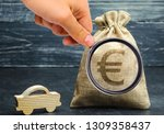 Small photo of Money bag with Euro sign and miniature car. The concept of saving money to buy a car. Auto insurance. Saving. Loan repayment. Amortization. Buy a vehicle