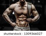 sexy strong bodybuilder...   Shutterstock . vector #1309366027