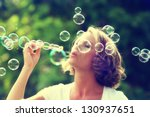 a beautiful woman blowing... | Shutterstock . vector #130937651