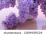 lilacs of bouquet in a white... | Shutterstock . vector #1309439224