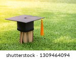book and black hat and yellow... | Shutterstock . vector #1309464094