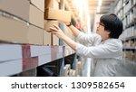 young asian shopper man picking ... | Shutterstock . vector #1309582654