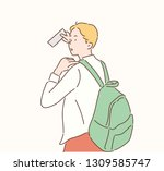 a man is carrying a backpack... | Shutterstock .eps vector #1309585747