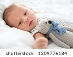 adorable newborn baby with toy... | Shutterstock . vector #1309776184