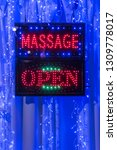 a 'massage open' sign hanging... | Shutterstock . vector #1309778017