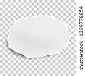 torn paper scrap of oval shape... | Shutterstock .eps vector #1309778854