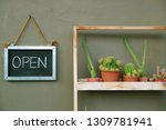 open sign board hanging on the... | Shutterstock . vector #1309781941