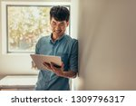 smiling man leaning to a wall... | Shutterstock . vector #1309796317