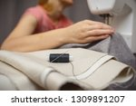 woman working with the machine... | Shutterstock . vector #1309891207