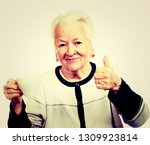 old woman with a cup of coffee... | Shutterstock . vector #1309923814