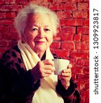 old woman enjoying coffee or... | Shutterstock . vector #1309923817