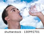 young latino drinking water... | Shutterstock . vector #130992701
