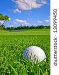 golf ball lies near the green - stock photo