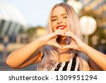 emotional blonde woman with red ... | Shutterstock . vector #1309951294