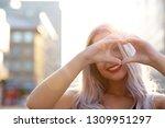 joyful blonde woman with red... | Shutterstock . vector #1309951297