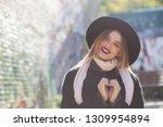 emotional blonde woman wearing... | Shutterstock . vector #1309954894