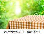empty checkered table background | Shutterstock . vector #1310035711