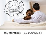 young thoughtful couple sitting ... | Shutterstock . vector #1310043364