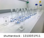 row of volumetric flask ... | Shutterstock . vector #1310051911