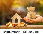 man hand hold money bag with... | Shutterstock . vector #1310052181