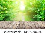 empty wooden table background | Shutterstock . vector #1310070301