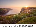 Sunset Over The Cliffs Of...