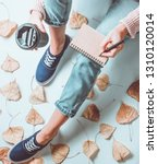 a girl in jeans and sneakers... | Shutterstock . vector #1310120014
