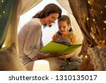 family  hygge and people... | Shutterstock . vector #1310135017