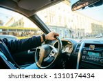 man driving car by city streets....   Shutterstock . vector #1310174434