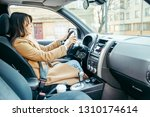 woman driving car view from...   Shutterstock . vector #1310174614