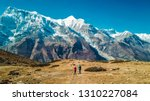 a couple walking on the... | Shutterstock . vector #1310227084
