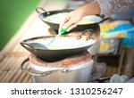 people while cooking... | Shutterstock . vector #1310256247